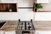 Close-up Steel Stove In Modern Stylish Light Grey Kitchen Interior With Furniture And Stainless Stee poster