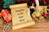 Old Paper Scroll With A Humorous Christmas Slogan, Naughty Is The New Nice Text poster