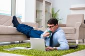 Businessman taking work home and working overtime poster