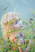Little Girl Plaing Alone At Riverside