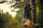 Romance In Nature. Fire Burn In Forest With Blurred Couple In Love Hug On Natural Landscape. Romance poster