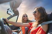 summer holidays, road trip, vacation, travel and people concept - happy young women driving in conve poster