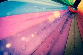 Multi-colored Colorful Umbrella With All Colors Of The Rainbow With Raindrops. Vintage, Grunge, Old, poster
