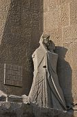 stock photo of judas  - Figure of the Judas kiss and the magic square on the Holy Passion facade of Sagrada Familia cathedral in Barcelona - JPG