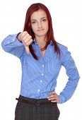 Sad redhead businesswoman shows thumb down gesture, isolated on white