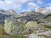 Mountain Ridge And Lichen Covered Boulders