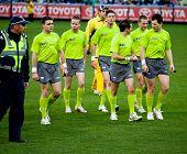MELBOURNE - JUNE 30 : Umpires leave the ground after Collingwood's win over Fremantle on June 30, 20