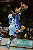 KAPOSVAR, HUNGARY - FEBRUARY 22: Kwadzo Ahelgebe (in white) in action at a Hungarian Cup basketball