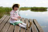 Laughing Little Girl On Lake Background