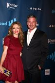LOS ANGELES - APR 20:  Rebecca Gayheart, Eric Dne arrives at the 2013 GLAAD Media Awards at the JW M