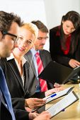Business - businesspeople have a meeting or workshop with presentation in office, they negotiate or