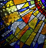 foto of stained glass  - part of stained glass panel of church with back lit - JPG