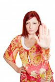 Woman reaching out with hand to keep distance