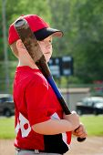 Portrait of child preparing to bat during organized league baseball game