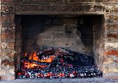 foto of ember  - Glow of embers preparing for outdoors charcoal - JPG