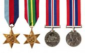 Collection of British and Australian World War II military medals, isolated on white.  Includes the