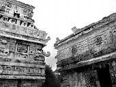 image of conquistadors  - Mayan ruins of Chichen Itza in Yucatan Mexico the Nunnery with Chac Masks - JPG