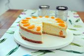 stock photo of tort  - Tasty torte with cream curd and manderines