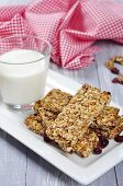 foto of roughage  - Muesli Bars on plate with nuts and dried fruits - JPG
