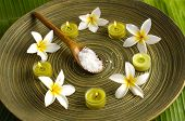 spa supplies frangipani with. salt in spoon image of tropical spa.