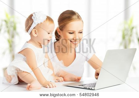 Mom And Baby With Computer Working From Home poster