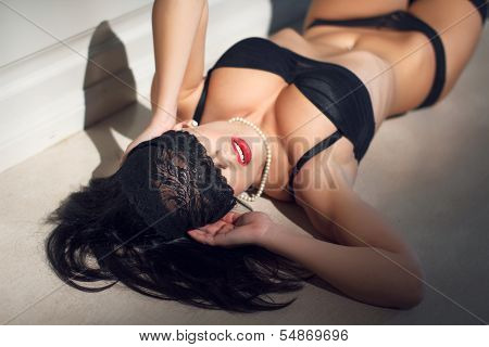 Young Sexy Woman With Lace Veil On Eyes poster