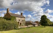 stock photo of farmhouse  - Pretty Cotswold stone farmhouse - JPG
