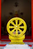stock photo of dharma  - Dharmachakra, the wheel of law, symbol of dharma of Buddhism