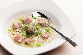 smoked meat bouillon with pearl barley and peas