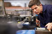 stock photo of hydraulics  - Factory Engineer Operating Hydraulic Tube Bender - JPG