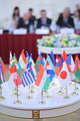 Table with 28 national flags at the International Congress of Industrialists and Entrepreneurs