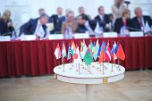 White table with 28 national flags at the International Congress of Industrialists and Entrepreneurs