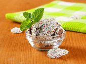 cookies with smarties, decorated with mint, served in a glass bowl