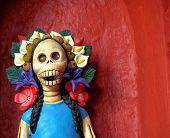 Mexico's traditional day of the dead Catrina close up with flowers on head