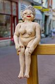 Figurine Of A Naked Woman Seated On The Railing   In Dordrecht, Netherlands
