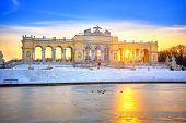VIENNA - DECEMBER 13 2012: Gloriette in Schonbrunn Palace, Vienna, Austria illuminated by sunset on