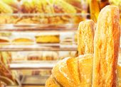 Fresh pastries lies on store shelves. Close-up photo.