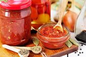 stock photo of marinade  - Makking tomato and herb sauce preserved Marinara - JPG