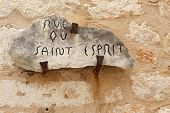 Old street sign carved into rock on the city wall of Saint Paul de Vence Franc