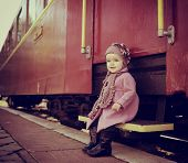 stock photo of child missing  - Little cute girl ready to vacation on railway station - JPG