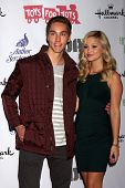 LOS ANGELES - DEC 1:  Austin North, Olivia Holt at the 2013 Hollywood Christmas Parade at Hollywood