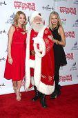LOS ANGELES - DEC 1:  Hunter King, Santa, Melissa Ordway at the 2013 Hollywood Christmas Parade at Hollywood & Highland on December 1, 2013 in Los Angeles, CA