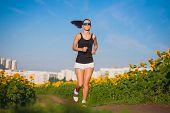 athlete on morning jog in the sunflower's field
