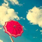 foto of defender  - photo vintage umbrella in the blue sky - JPG