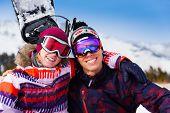 Hugging couple in ski masks together