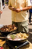 stock photo of gyro  - Cooking Greek gyros at the Farmers Market. ** Note: Shallow depth of field - JPG