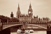 Westminster Palace and bridge over Thames River in London in black and white