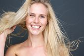 Smiling Young Blond Woman With Blowing Hair