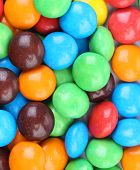 Background of chocolate balls in colorful glaze.
