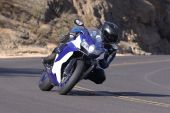 foto of crotch-rocket  - High speed motorcycle sportbike on mountain road - JPG